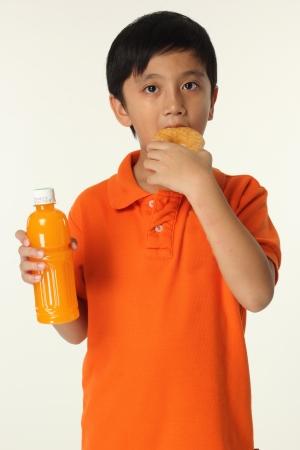 dough nut: Kit eating dough nut with orange juice