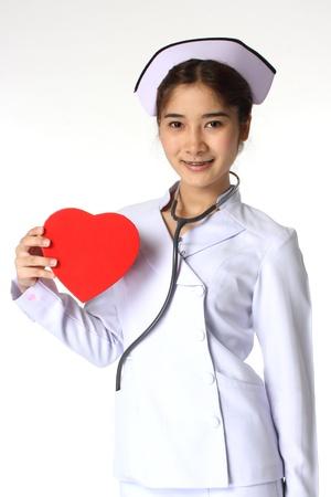 Nurse holding a chocolate box with the shape of a heart