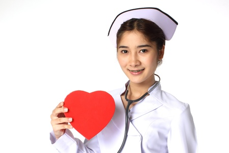 Nurse holding a chocolate box with the shape of a heart  photo