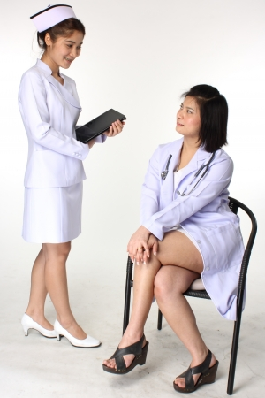 prognosis: Doctor discussing prognosis with nurse  Stock Photo