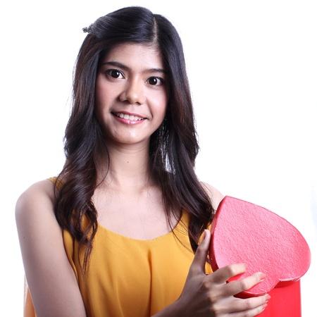 Asian beautiful woman opening a chocolate box