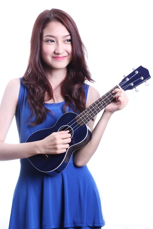 Cute asian woman playing ukulele  photo