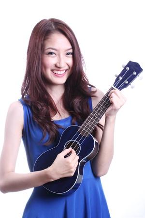 Cute asian woman playing ukulele  Stock Photo