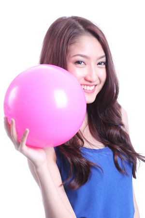 Asian woman playing pink ball on white background photo