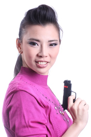 Asian woman holding a gun on white background  photo