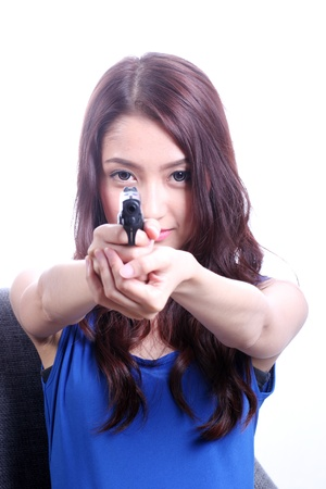 Shoot them up  Asian woman with the gun on her hand  photo