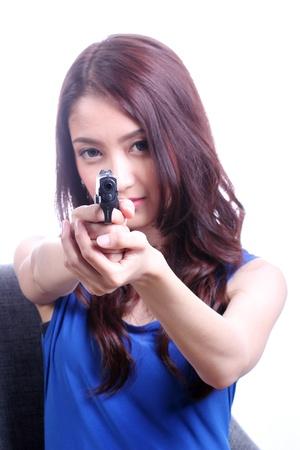 Asian Woman with handgun on white  Selective focus  photo