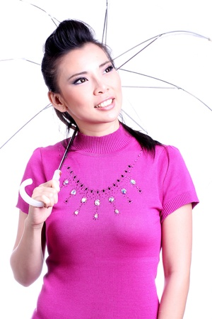 Happy young woman standing with a white umbrella photo