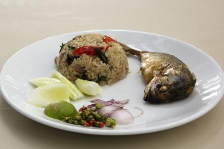 Fried rice with fried Mackerel photo