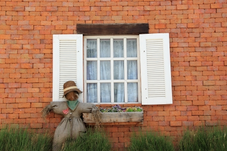 Old vintage door and scarecrow Stock Photo - 21522506