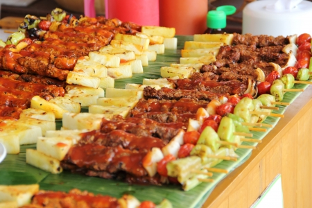 broiling: barbecue sticks with meat and vegetables