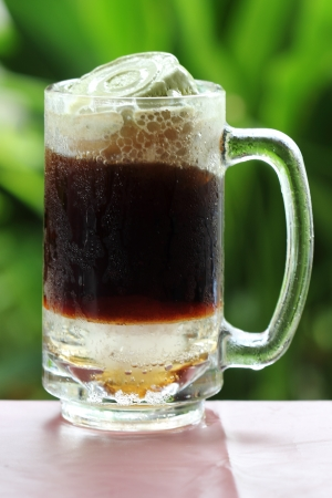 root beer: Root beer float, a tasty summer treat on Green tree background