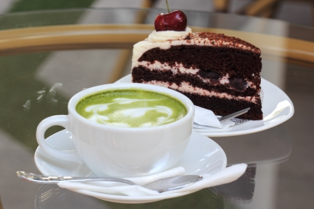 forest tea: Green tea latte and Black Forest cake Stock Photo