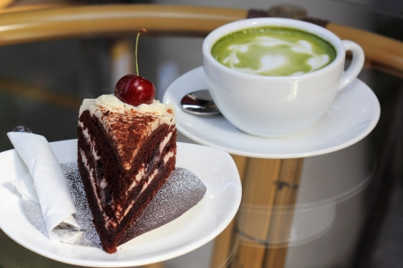 Green tea latte and Black Forest cake photo