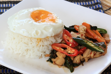 fried basil chicken with fried egg and rice  Krapao Gai     Thai Spicy Food  photo