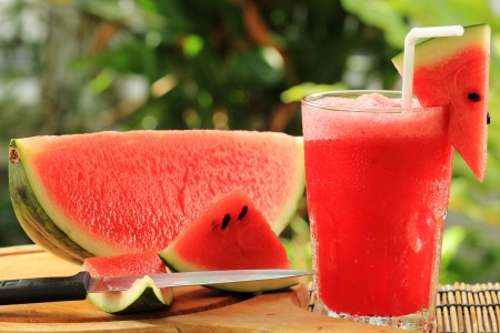 Fresh watermelon smoothie served in the garden Stock Photo