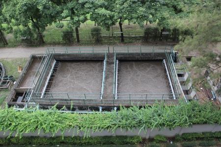 sedimentation: Sedimentation tanks in a sewage treatment plant on top view  Stock Photo