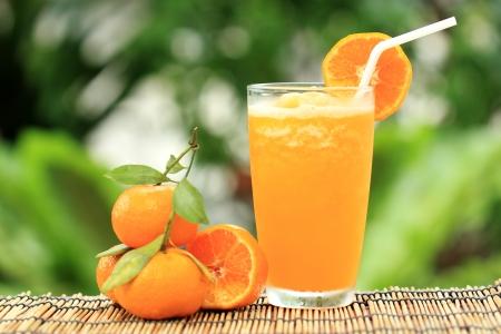 Group of Orange and orange Smoothie on garden background