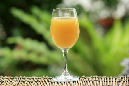 non vegetarian: Fresh pineapple juice in the wine grass selective focus Stock Photo