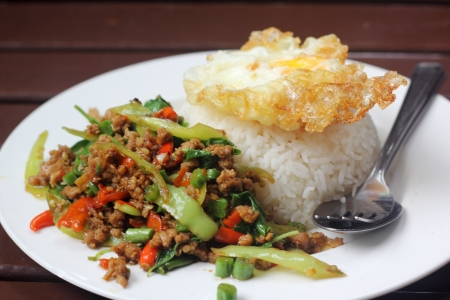 stir fried minced pork and chili ,basil served with steamed rice and fried egg photo