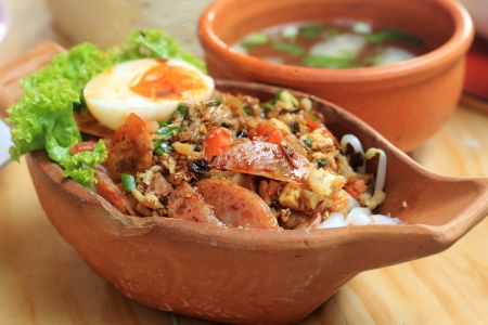 soysauce: Steam rice noodle topping with soysauce ,dry shrimp, preserved pork and boiled egg  Chinese food,thai style Stock Photo