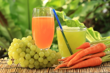 glass of fresh carrot juice and Grape juice smoothie