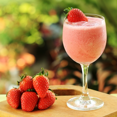 Refreshing Strawberry smoothie drink on the table  photo