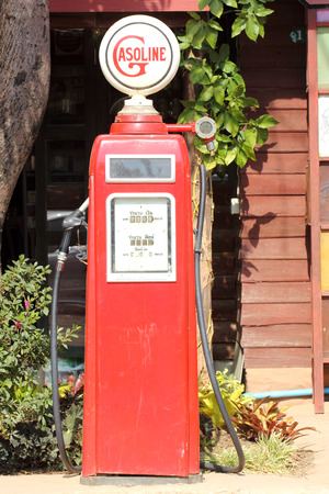 red retro gasoline pump in the old gasoline station photo