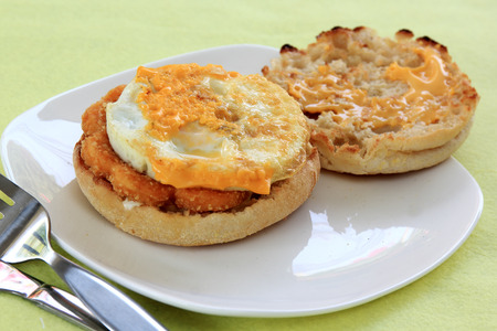 Muffin for breakfast with chicken and fried egg  photo