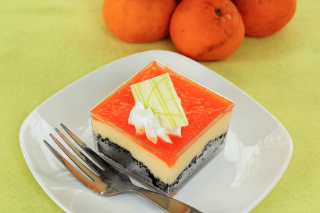 cheese cake: Orange Biscuit cake Layer with cheese cake in Plastic box