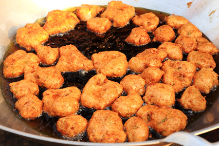 Deep frying fish cake for sale in market  photo