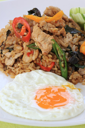 Fried rice with basil, chili and pork (Khao Pad Krapao Moo)  Thai Spicy Food photo