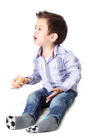 dough nut: Boy eating dough nut Isolate on White background Stock Photo