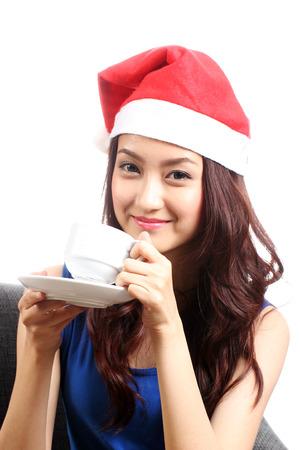 Asian woman drinking the coffee in studio shot photo