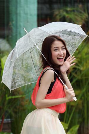Portrait of Asian beautiful female with umbrella