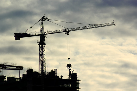 Construction site with crane and building in downtown of bangkok thailand photo