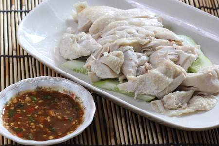Slide steamed chicken on the plate with spicy salted soya beans sauce photo