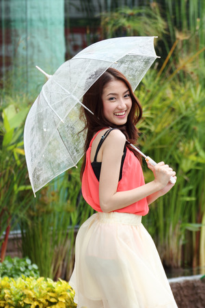 Portrait of Asian beautiful female with umbrella  photo