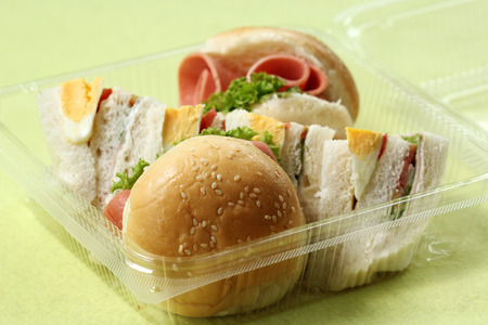 packaged: Hamburger and sandwich in box for take home   Selective Focus