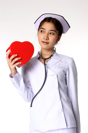 Nice asian nurse holding a symbol of heart photo