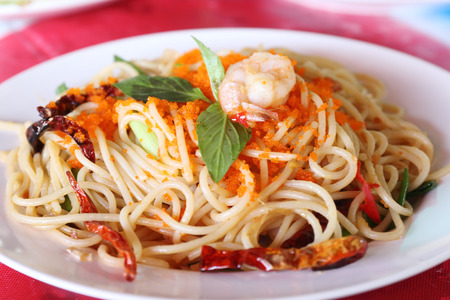 Spaghetti with shrimp and orange capelin roe  photo
