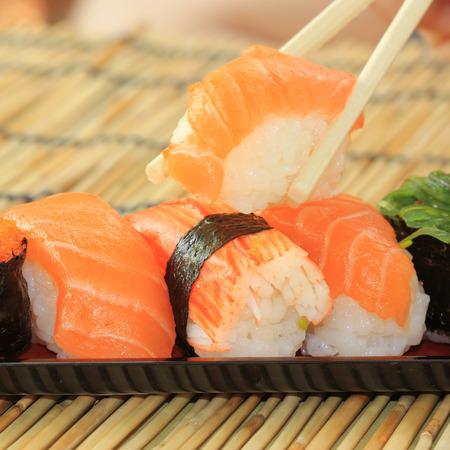 Japanese food  salmon,shrimp,seaweed sushi in the tray  photo