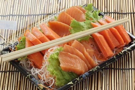 Fresh Salmon sashimi set in the box   Japanese food photo