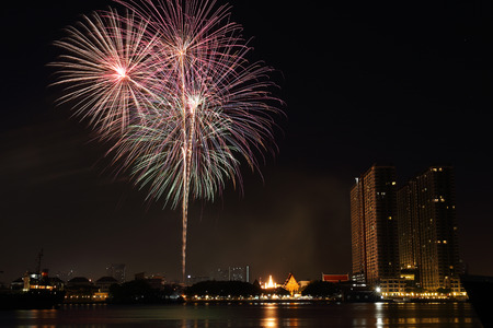Fireworks near the river in Bangkok, Thailand photo