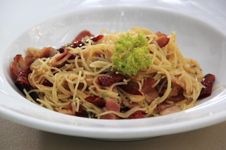Spaghetti stir fried with spicy smoke Ham photo