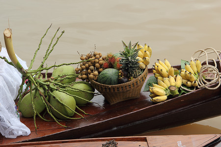 Tropical fruit on the boat at  Floating Market in Thailand  photo