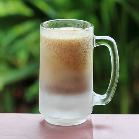 root beer: Old and cold Fashion mug of Root beer and foam Stock Photo