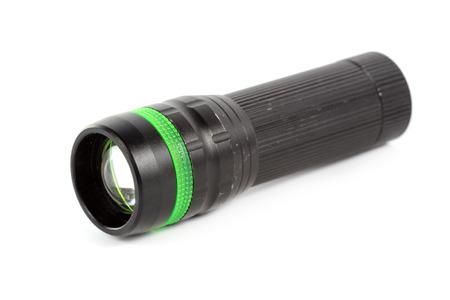 Black plastic flashlight isolated on white background photo