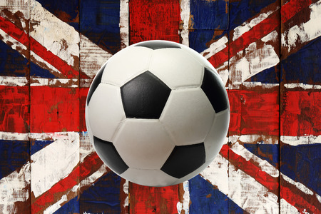 Great britain flag  on old wood with ball photo