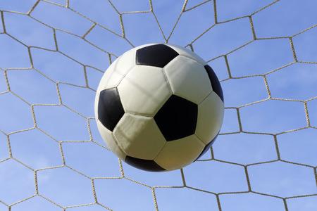 soccer goal: Soccer foot ball in the goal net